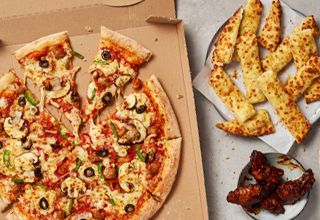 Upgrade to a large pizza and any two sides