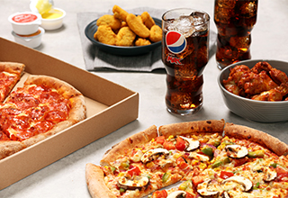 Two Medium Pizzas, Two side and a Large drink for £22.99