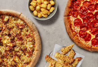 Two Large Pizzas, two sides and a Large drink for £28.99. Extra sugar drinks levy charge may apply.